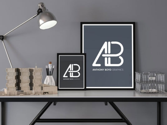 Two Posters on a Desk Mockup