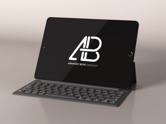 Realistically rendered mockup of an iPad Pro (black) with a keyboard Layered PSD file with smart object. Dimensions: 4000 x 3000 px.